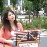 Beautiful japanese girl sing with ghita in front of akihabara station