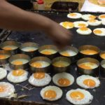 Japanese Street Food – Eggs with Octopus-Flavored Rice Cracker in Festival