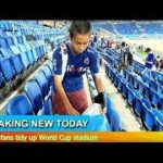 Breaking News – Japan fans tidy up World Cup stadium