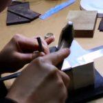 Learning hand engrave Japanese kitchen knife at Sakai Takayuki