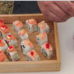 Street Food from Japan in Italy. Preparing Sushi Rolls